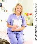 nurse with stethoscope and... | Shutterstock . vector #1277363770