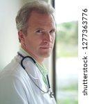 portrait of doctor in white... | Shutterstock . vector #1277363776