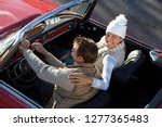loving mature couple driving... | Shutterstock . vector #1277365483