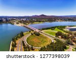 Small photo of Commonwealth avenue and bridge over Burley Griffin lake in Canberra between city CBD and federal government capital hill triangle area with local streets, roads, parks and buildings.