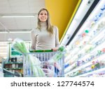 Beautiful woman shopping in a supermarket - stock photo