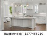 beautiful white kitchen in new... | Shutterstock . vector #1277455210