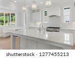 beautiful white kitchen in new... | Shutterstock . vector #1277455213