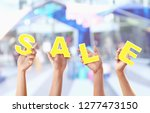 concept of discount. hands...   Shutterstock . vector #1277473150