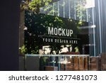 window sign mockup in a shop | Shutterstock . vector #1277481073