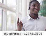 modern african man listening to ... | Shutterstock . vector #1277513803