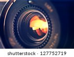 objective in yellow light. ... | Shutterstock . vector #127752719