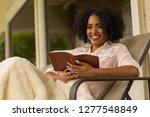 happy woman reading.   Shutterstock . vector #1277548849