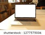 laptop mockup on white desk... | Shutterstock . vector #1277575036