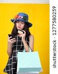 happy woman in black dress on... | Shutterstock . vector #1277580259