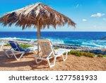 sunbeds under umbrella on... | Shutterstock . vector #1277581933