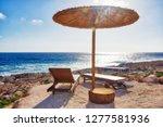 relaxation on sunbeds under... | Shutterstock . vector #1277581936