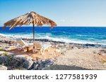beautiful tropical rocky beach... | Shutterstock . vector #1277581939
