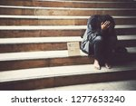 homelessness sits on the ground ... | Shutterstock . vector #1277653240