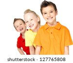 Portrait of the happy children isolated on white.  Schoolchild friends standing together and looking at camera - stock photo