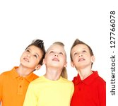 Portrait of the happy children looking up - isolated on white - stock photo