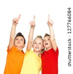 Portrait of the happy children point up by fingers on something away -  isolated on white - stock photo
