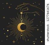 hand holding crescent moon.... | Shutterstock .eps vector #1277661676
