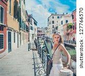 beautiful girl is standing by... | Shutterstock . vector #127766570