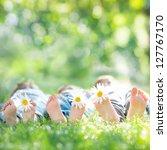 Family With Daisy Flowers Lyin...