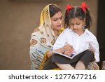 rural mother helping daughter... | Shutterstock . vector #1277677216