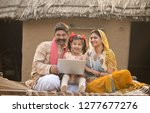 rural indian family using... | Shutterstock . vector #1277677276