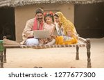rural indian family using... | Shutterstock . vector #1277677300