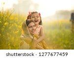 mother with daughter having fun ... | Shutterstock . vector #1277677459