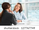 two business women talking and... | Shutterstock . vector #127767749