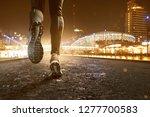 runner at night | Shutterstock . vector #1277700583