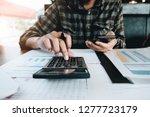 a man working about financial... | Shutterstock . vector #1277723179