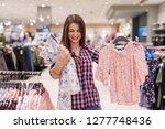 young beautiful brunette... | Shutterstock . vector #1277748436