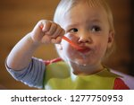 child eating independently with ... | Shutterstock . vector #1277750953
