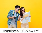 happy asian couple tourists... | Shutterstock . vector #1277767429