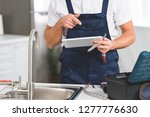 cropped view of repairman... | Shutterstock . vector #1277776630