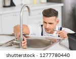 adult repairman holding pipe... | Shutterstock . vector #1277780440