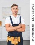 adult repairman in tool belt... | Shutterstock . vector #1277781913
