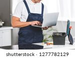 cropped view of adult repairman ... | Shutterstock . vector #1277782129