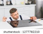 thoughtful adult repairman... | Shutterstock . vector #1277782210