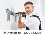 smiling adult repairman... | Shutterstock . vector #1277782306
