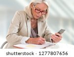 senior woman executive with... | Shutterstock . vector #1277807656