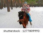 Little Cute Girl Riding A...