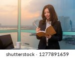 asian woman making notes in... | Shutterstock . vector #1277891659