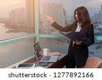 asian woman holding folder of... | Shutterstock . vector #1277892166