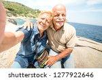 senior couple vacationer taking ... | Shutterstock . vector #1277922646