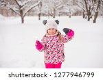 kid girl 5 6 year old holding...   Shutterstock . vector #1277946799