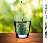 glass of water on wood with... | Shutterstock . vector #127799168