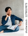 confident asian man sitting on... | Shutterstock . vector #1278019873