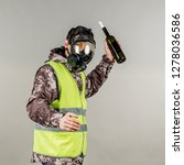 rebel with gas mask on gray... | Shutterstock . vector #1278036586
