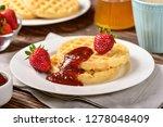 waffles and jam on breakfast... | Shutterstock . vector #1278048409